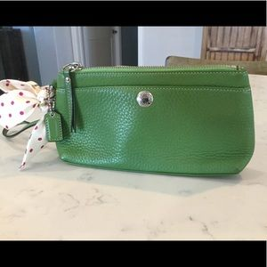 Soft leather Coach wristlet with bow